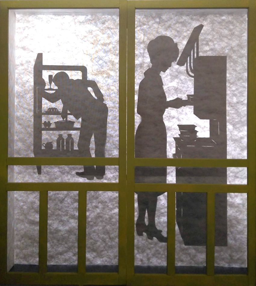 Silhouettes of a woman making TV dinners and a man looking into a refrigerator